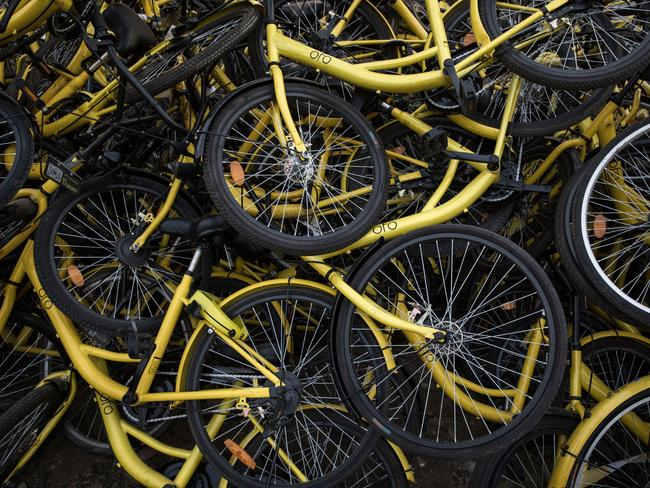 Despite being the market leader in China, Ofo bikes are still ending up being dumped. Picture: Kevin Frayer/Getty Images