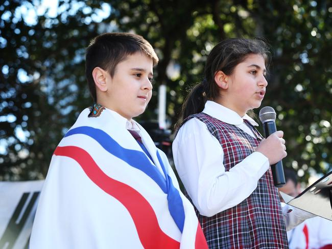 Nineal Hawei and Chloe Younan, both 11, are the school captains of St Hurmzd Assyrian Primary School who spoke to the crowd gathered at Belmore Park. Picture: Craig Greenhill