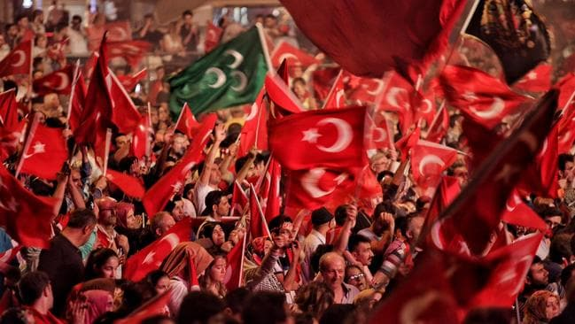 Supporters of Turkish President Tayyip Erdogan wave flags as they gather in Istanbul's central Taksim Square yesterday in Istanbul. Picture: Kursat Bayhan/Getty Images