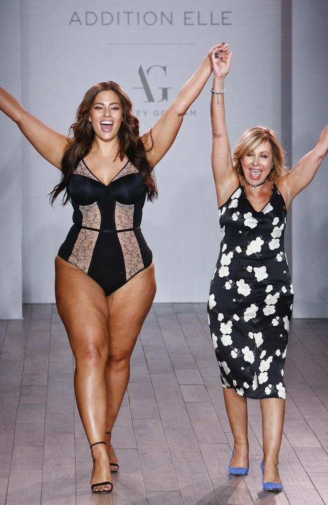 Ashley Graham (L) appears on the runway for Addition Elle.