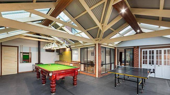 "<a href=""https://www.realestate.com.au/property-house-vic-narre+warren+south-126083326"">1 Berkshire Place, Narre Warren South</a>, has an enclosed veranda as a games room."
