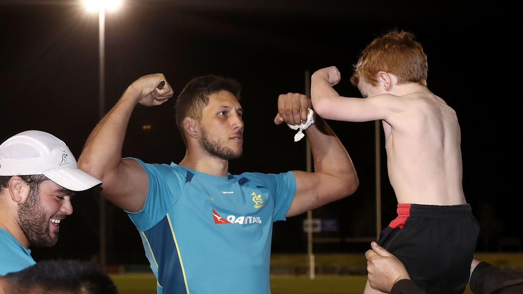 Adam Coleman and a young Wallabies supporter flex at each other at Cessnock Sportsground.