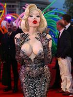 STARS reveal flesh and more than a little cheek at this year's Life Ball - Europe's biggest and most outrageous charity gala. Iconic transgender performer Amanda Lepore struts the red carpet. Picture: Splash