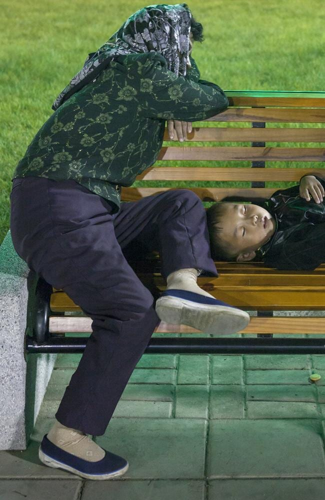 'Paranoia is strong in North Korean minds. I took this picture at a funfair of a tired mother and child resting on a bench. I was asked to delete the picture since the guides were certain I would have said those people were homeless.'