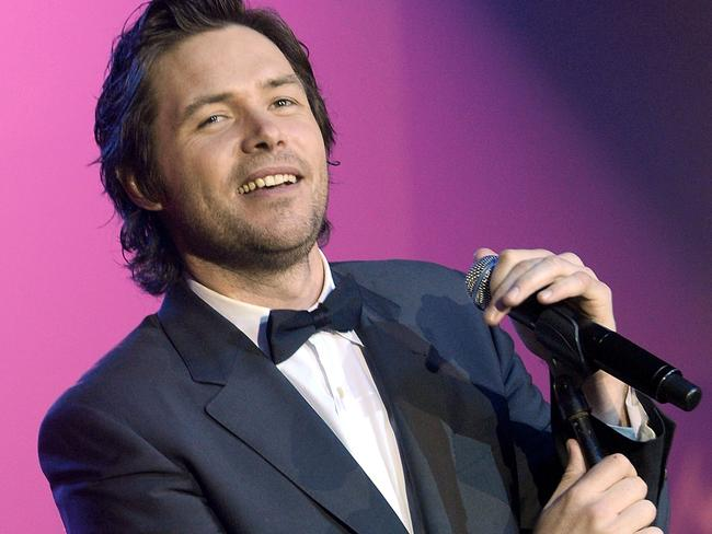 "Johns performs at a ""Celebrity Fight Night"" event in Phoenix, Arizona, in 2010 Picture: Getty"