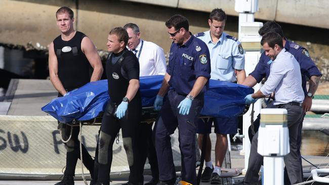 Police recovered a body found wrapped in plastic and floating in water near Shelly Beach / Picture: Cameron Richardson.