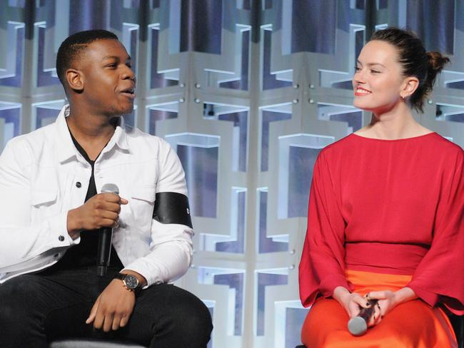 John Boyega with co-star Daisy Ridley on the Star Wars: The Last Jedi panel. Picture: Gerardo Mora/Getty Images for Disney