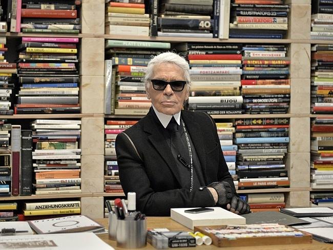 FILE — In this Feb. 14, 2014 file photo, fashion icon Karl Lagerfeld poses for photograph
