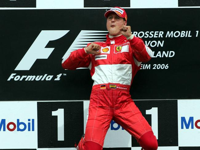 Michael Schumacher jumps up on the podium after winning the Formula 1 Grand Prix of Germany at the Hockenheim Ring circuit in 2006.