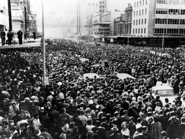 Fans crowd King William St for The Beatles' Town Hall welcome.
