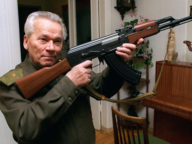 Man with a gun ... Russian inventor Mikhail Kalashnikov with his world-famous AK-47 assault rifle. Picture: Vladimir Vyatkin