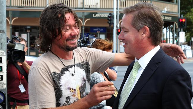 Jacob Brookes jokes around with Ten Eyewitness News television reporter Alan Murrell outside the Port Adelaide Magistrates Court earlier this year.