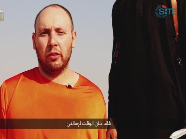 This image made from video posted on the internet by Islamic State militants purports to show journalist Steven Sotloff before he was beheaded.