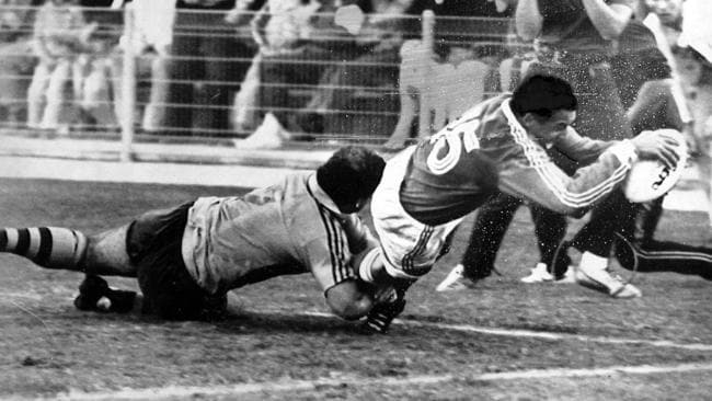 Serge Blanco dives across the line to score the winning try for France against Australia in the 1987 World Cup semi-final.