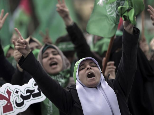 Palestinian Hamas supporters chant Islamic slogans as they attend a rally.