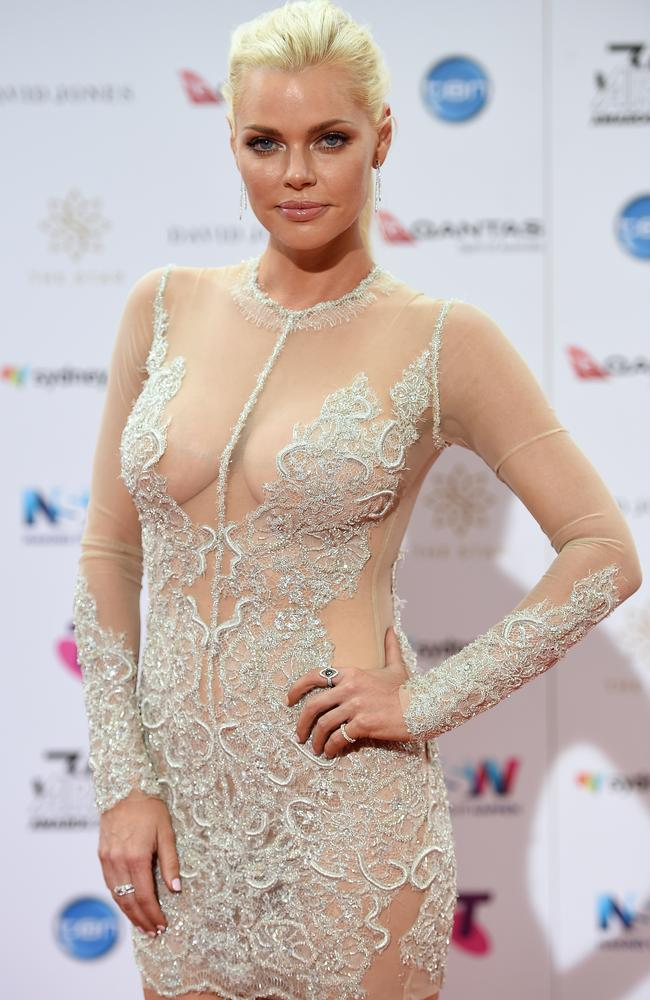Sophie Monk shows a hint of nip.