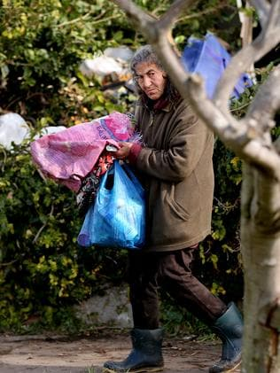 Mary Bobolas, collecting rubbish, says 'when I have stress I go out and collect things'. Picture: John Grainger
