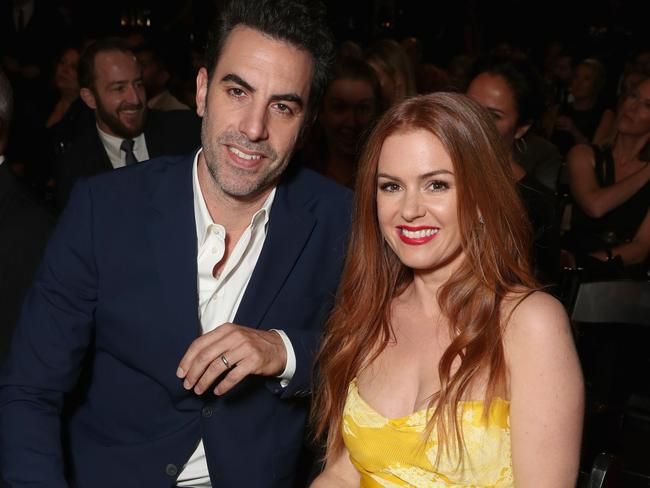 Cohen, pictured with wife Isla Fisher, came to the tourists' rescue. Picture: Todd Williamson/Getty Images for AACTA