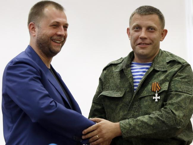 "Outgoing Prime Minister Alexander Borodai, left, shakes hands with Alexander Zakharchenko, who has been put forward as the new Prime Minister of the self-declared ""Donetsk People's Republic"". Picture: Sergei Grits"