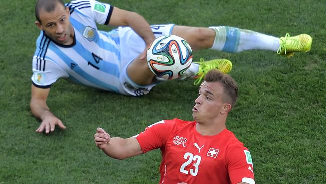 Xherdan Shaqiri leaves Javier Mascherano on the ground.