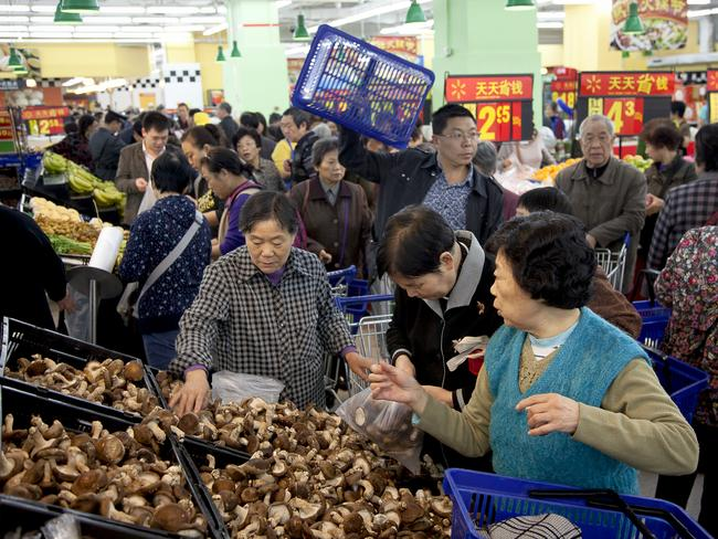 Chinese consumers in a Walmart in Chongqing. American companies are looking to woo China's 1.3 billion consumers.