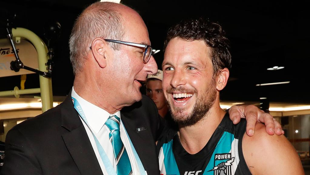 Power chairman David Koch with captain Travis Boak in happier times after the first AFL game in Shanghai, China. Picture: Michael Willson/AFL Media/Getty Images