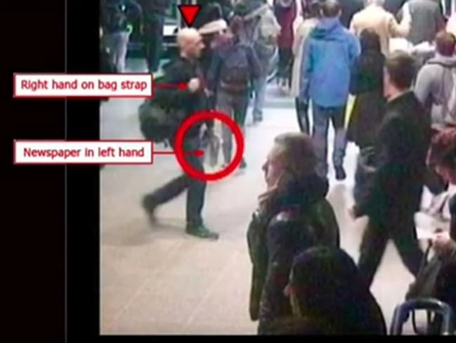 CCTV footage shows Mark Pearson never took his hands off his bag or his newspaper. Picture: BBC