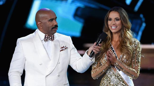 Stay focused ... Steve Harvey quizzes Miss Australia Monika Radulovic about marijuana legalisation during the 2015 Miss Universe Pageant.