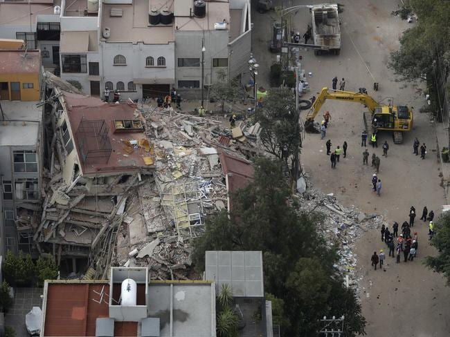 A crew works alongside a collapsed building in the Del Valle area of Mexico City. Picture: Rebecca Blackwell/AP