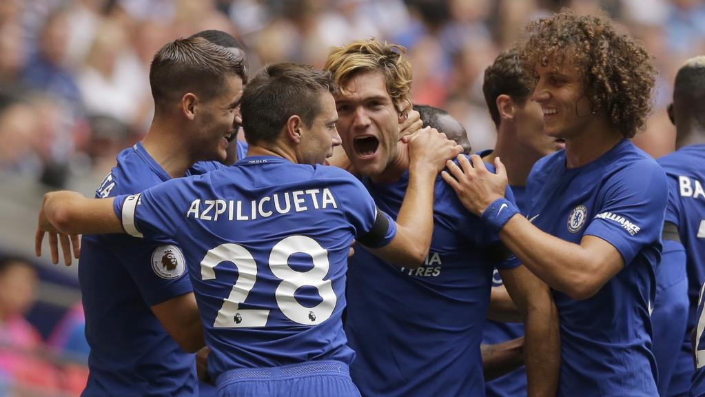 Chelsea's Marcos Alonso, centre, celebrates.