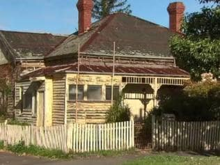 Police are investigating why a woman was trapped under a derelict Melbourne house for four days. The woman, aged in her 30s, was freed from under the Essendon house last night. Picture: Nine News