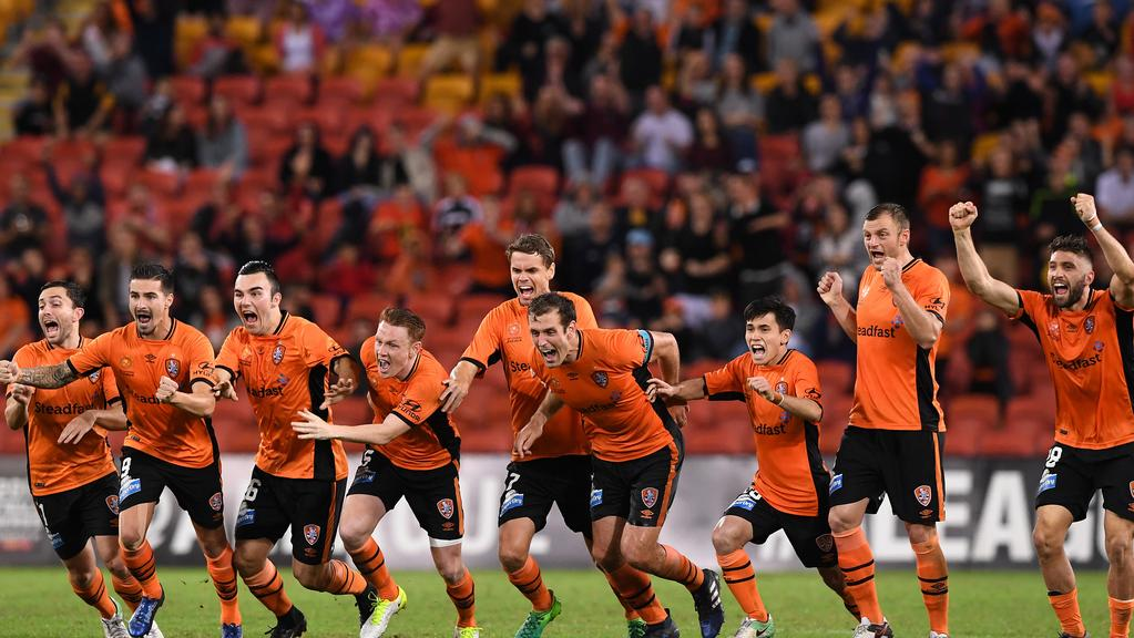The Brisbane Roar team celebrate after their goal keeper Jamie Young saved a penalty shot.