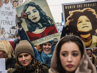 "Women hold posters as they take part in a march for women's rights and freedom in solidarity with the march organised in Washington, on January 21, 2017 in Pristina. Hundreds of thousands of protesters spearheaded by women's rights groups are set to converge on Washington to send a defiant message to America's new president, Donald Trump. Powered by social media, the ""Women's March on Washington"" aims to draw 200,000 people, illustrating the divisions of a country whose incoming leader faces levels of public mistrust unseen in recent decades. / AFP PHOTO / Armend NIMANI"