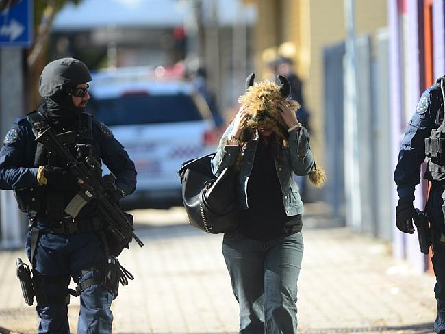 STAR Group officers with one of the women after she left the massage parlour. Picture: Tom Huntley