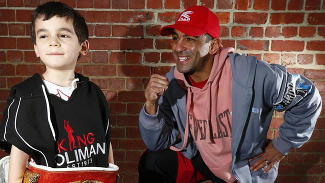Sam Soliman lets his 4 1/2 year old son Samir try on his World Championship belt.