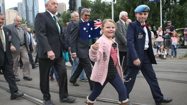 Children taking part in the march alongside veterans. Picture: David Crosling