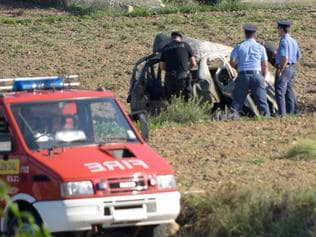 Police inspect the wreckage of a car bomb believed to have killed journalist and blogger Daphne Caruana Galizia close to her home in Bidnija, Malta? on October 16, 2017. The force of the blast broke her car into several pieces and catapulted the journalist's body into a nearby field, witnesses said. She leaves a husband and three sons. Caruana Galizia's death comes four months after Prime Minister Joseph Muscat's Labour Party won a resounding victory in a general election he called early as a result of scandals to which Caruana Galizia's allegations were central. / AFP PHOTO / STR / Malta OUT