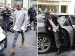 Ray West a (on right)nd his son, musician Kanye West, get out of a car on May 22, 2014 in Paris. Picture: AFP