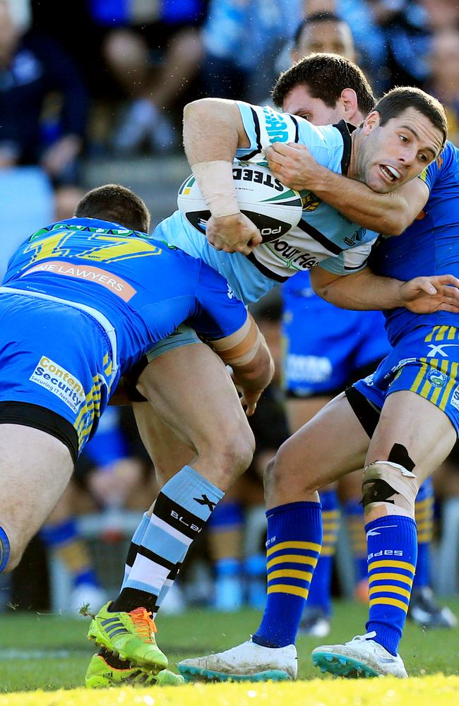 Michael Gordon tries to find some space for Cronulla.