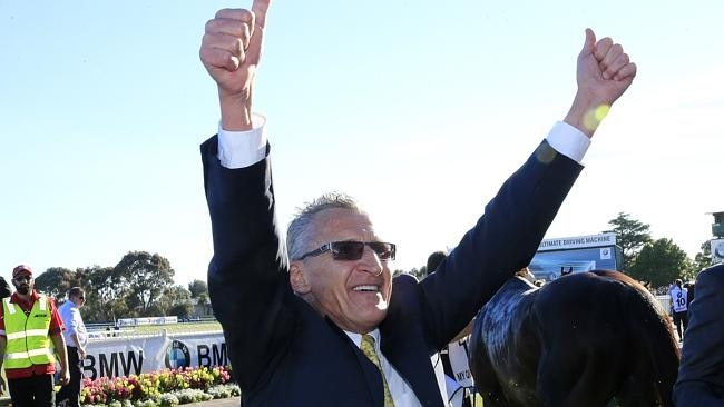 Greg Hall celebrates in the mounting yard after Fawkner's Caulfield Cup.win. Picture: Wayne Ludbey