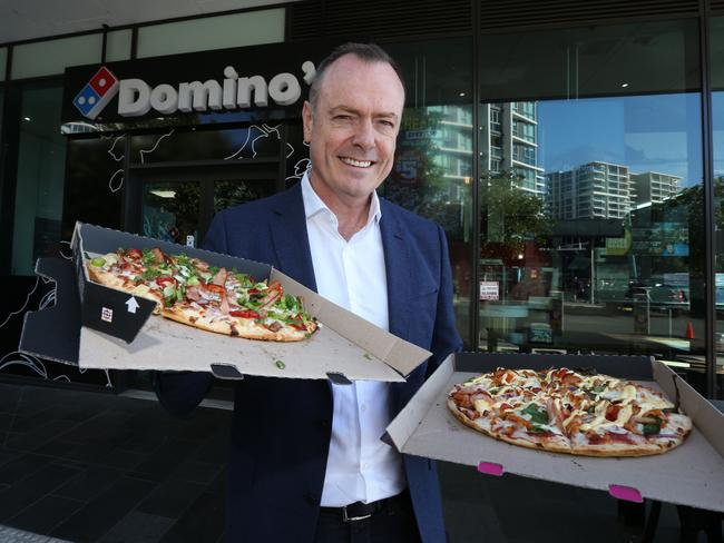 Domino's CEO Don Meij with his company's pizzas. Picture: Annette Dew