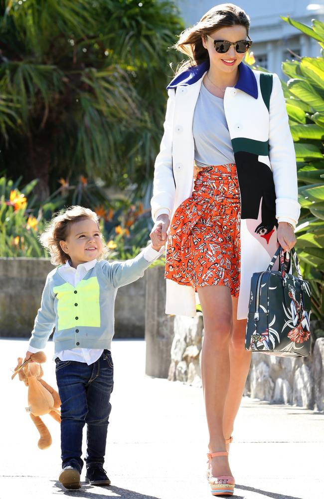 Seventh hottest... Aussie girls ranked far below the guys in hottness. Here Miranda Kerr walks with her son Flynn in Sydney. Picture Cameron Richardson