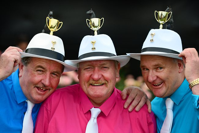 Ian, David and Dallas, all from Hobart, enjoy the festive spirit at the Melbourne Cup. Picture: Alex Coppel