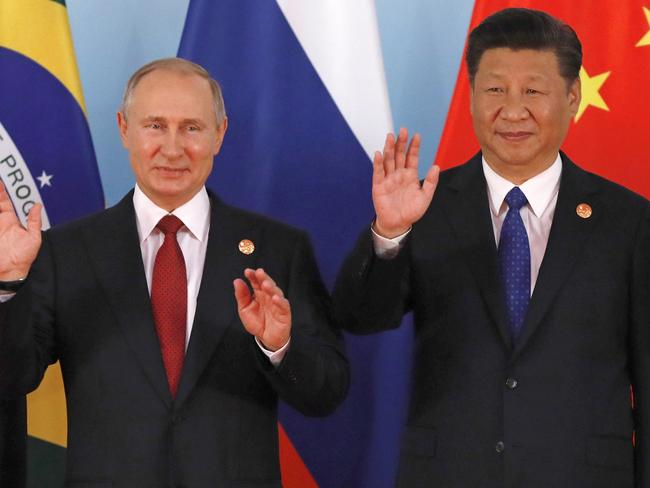 North Korea does have friends including Chinese President Xi Jinping, right, and Russian President Vladimir Putin. Picture: Tyrone Siu/AP