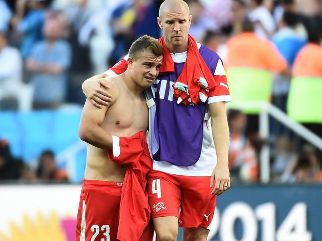Swiss midfielder Xherdan Shaqiri and defender Philippe Senderos console each other after the heartbreaking loss.