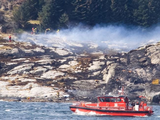 A search and rescue vessel patrols off the island of Turoey, near Bergen in Norway, as emergency workers attend the scene of a helicopter crash. Picture: Rune Nielsen/NTB scanpix via AP