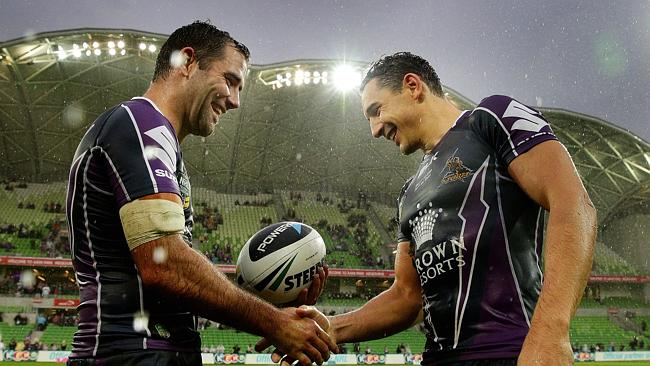 Cameron Smith presents Billy Slater with the match ball after his 250th game.