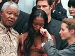 PIRATE: South African President Nelson Mandela (C) poses with model Naomi Campbell (2nd R) and model Christy Turlington (R) at Genadendal, his Cape Town home 13/02/98. Campbell has brought the last haute couture collection shirt designed by Gianni Versace and his sister Donatella to Cape Town and all proceeds will go the Nelson Mandela Children's Fund.