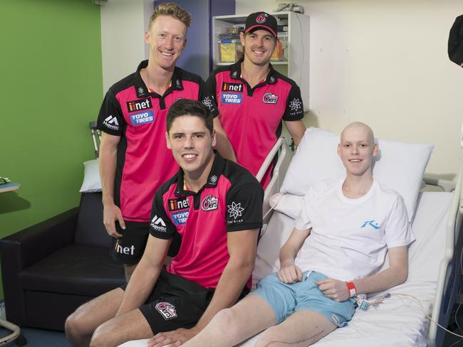Cricket fanatic Nicolas met Sydney Sixers players Joran Silk, Daniel Hughes and Ben Dwarshius. Picture: Darren Leigh Roberts