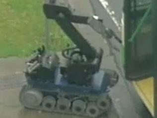 A bomb squad robot searches for threats in Moonee Ponds. Image: Channel 7